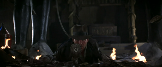 RAIDERS OF THE LOST ARK -- Indy stares into the eyes of a cobra