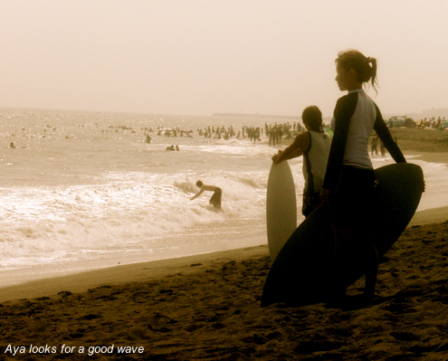 Aya looks for a good wave . . .